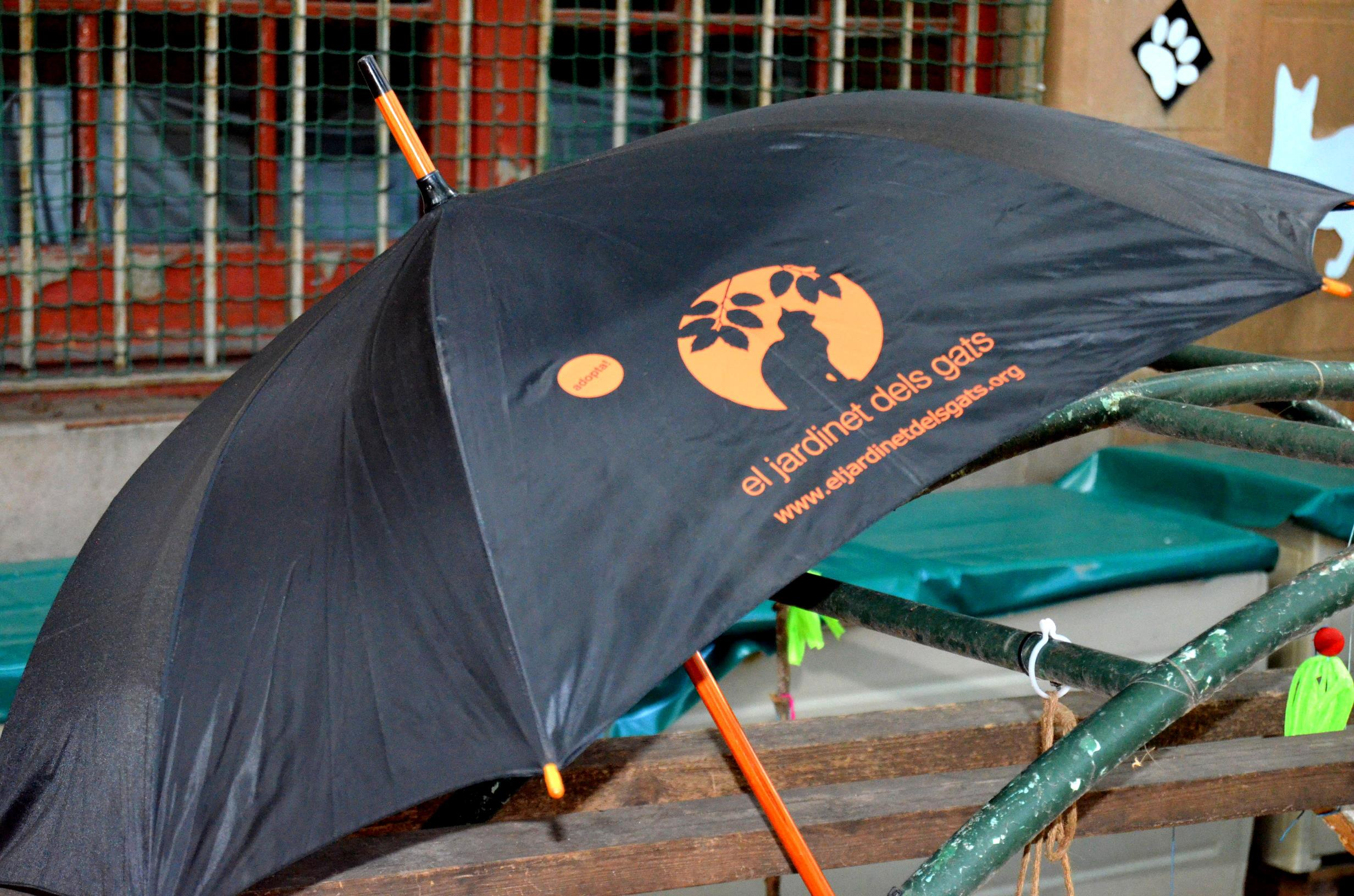 Paraigües, logo Jardinet dels gats Image